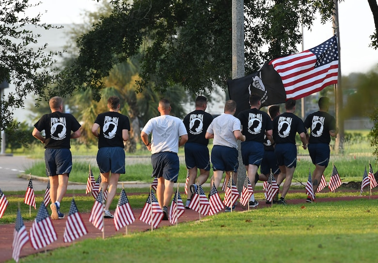 Members of the 81st Training Support Squadron participate in Keesler's POW/MIA 24-hour memorial run and vigil at the Crotwell Track at Keesler Air Force Base, Mississippi, Sept. 20, 2018. The event was held to raise awareness and pay tribute to all prisoners of war and those military members still missing in action. (U.S. Air Force photo by Kemberly Groue)