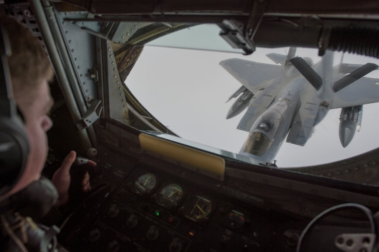U.S. Air Force Technical Sargent Michael Voorhees, with 909th Air Refueling Squadron, refuels an F-15C in support of Valiant Shield, on Sept 20, 2018. Valiant Shield is a U.S. only, biennial field training exercise (FTX) with a focus on integration of joint training in a blue-water environment among U.S. forces. This training enables real-world proficiency in sustaining joint forces through detecting, locating, tracking, and engaging units at sea, in the air, on land, and in cyberspace in response to a range of mission areas. (U.S. Navy photo Mass Communication Specialist 3rd Class Darienne Slack)