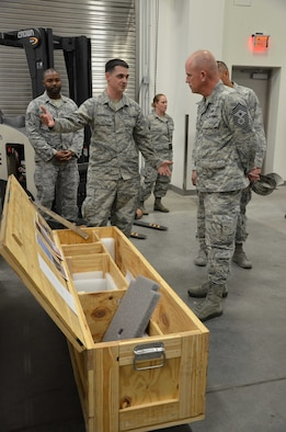 Tech. Sgt. Timothy Kavanagh, noncommissioned officer-in-charge of product support for the Air Force Technical Applications Center, Patrick AFB, Fla., explains to Chief Master Sgt. Frank Batten, command chief of Air Combat Command, how he designed a crate to better ship, house and store AFTAC's precision seismic equipment that is used to monitor worldwide nuclear activity.  (U.S. Air Force photo by Susan A. Romano)