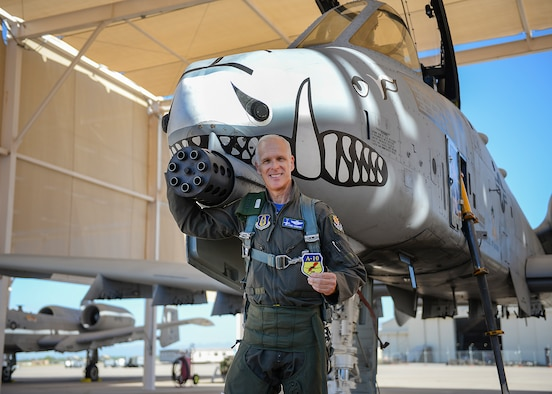 U.S. Air Force Lt. Col. Robin T. Sandifer, 47th Fighter Squadron A-10 Thunderbolt II instructor pilot, poses with the 5,000 flight hours milestone patch in front of an A-10 at Davis-Monthan Air Force Base, Ariz., Sept. 21, 2018. Sandifer reached this milestone after flying the A-10 for the last 29 years. (U.S. Air Force photo by Airman 1st Class Kristine Legate)