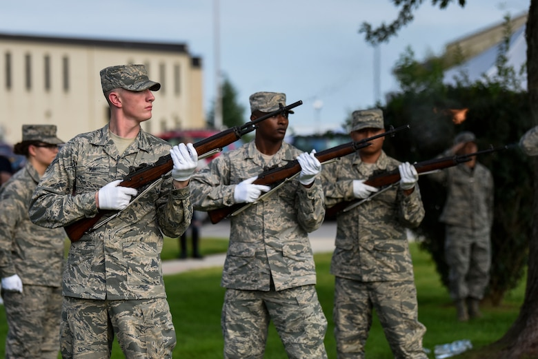 The Dover Air Force Base Honor Guard performs a rifle salute during a POW/MIA retreat ceremony Sept. 21, 2018, at Dover AFB, Del. During the ceremony the names of every missing American repatriated in 2018 were read. (U.S. Air Force photo by Airman 1st Class Zoe M. Wockenfuss)