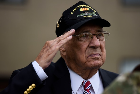 Retired Air Force Col. Murphy Neal Jones, Vietnam War veteran, salutes during the national anthem at a POW/MIA retreat ceremony Sept. 21, 2018, at Dover Air Force Base, Del. Jones spent more than six years as a POW during the Vietnam War and was repatriated in February 1973. (U.S. Air Force photo by Airman 1st Class Zoe M. Wockenfuss)