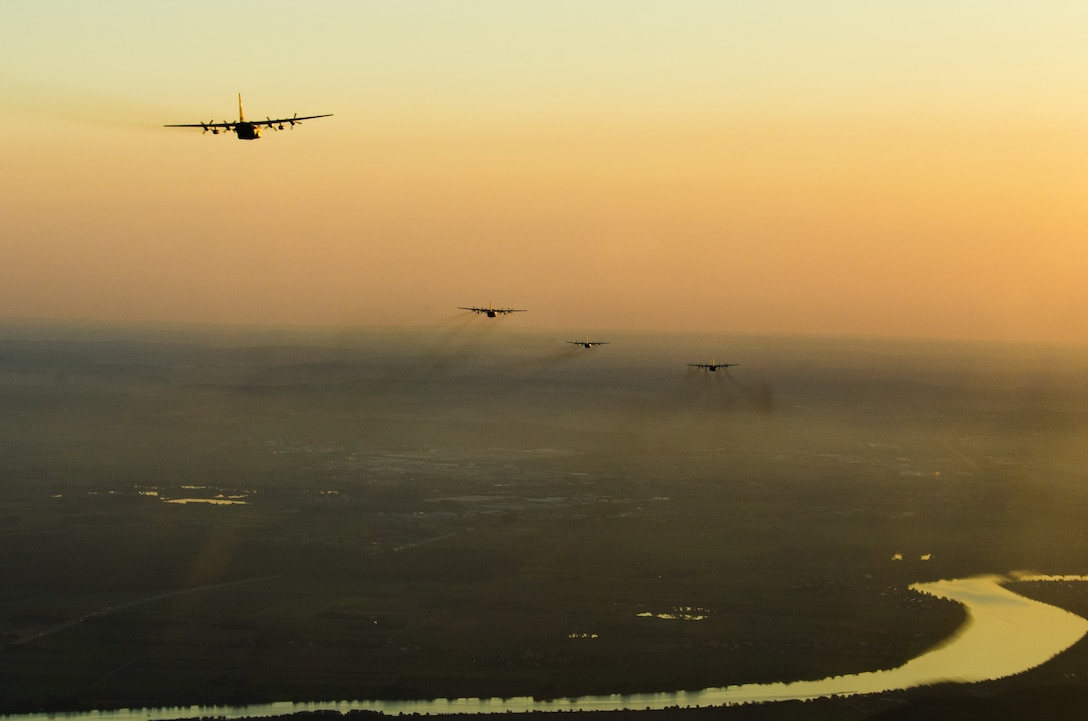 U.S. Air Force C-130 Hercules aircraft from various Air National Guard and Air Force Reserve units, as well as allied nations, participate in a personnel drop during Saber Junction 18 above Germany, Sept. 19, 2018. Saber Junction 18 is the U.S. Army 173rd Airborne Brigade's combat training center certification exercise, taking place on the Grafenwoehr and Hohenfels training areas. The U.S. Army Europe-directed exercise is designed to assess the readiness of the brigade to conduct unified land operations in a joint, combined environment and to promote interoperability with participating allies and partner nations. Saber Junction 18 includes nearly 5,500 participants from 20 ally and partner nations. (U.S. Air National Guard photo by Staff Sgt. Patrick Evenson)