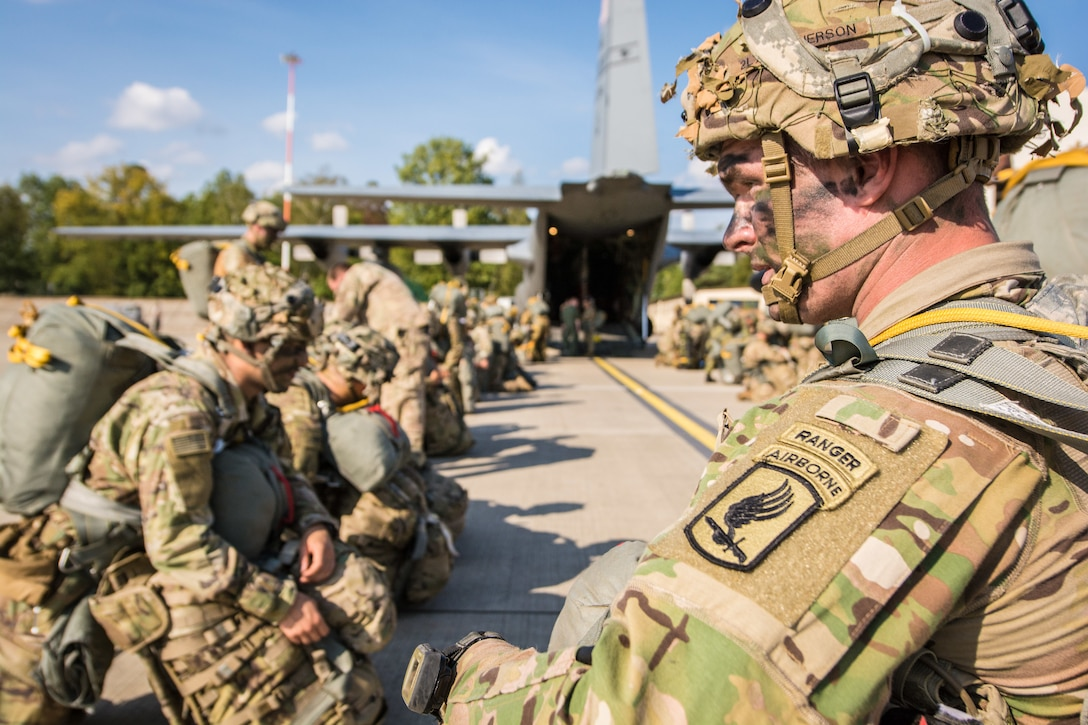 U.S. Army paratroopers with the 173rd Airborne Brigade sit and wait to board a U.S. Air Force C-130 aircraft assigned to the 139th Airlift Wing, Missouri Air National Guard, during Saber Junction 18, at Ramstein Air Base, Germany, Sept. 19, 2018. Saber Junction 18 is the U.S. Army 173rd Airborne Brigade's combat training center certification exercise, taking place on the Grafenwoehr and Hohenfels training areas. The U.S. Army Europe-directed exercise is designed to assess the readiness of the brigade to conduct unified land operations in a joint, combined environment and to promote interoperability with participating allies and partner nations. Saber Junction 18 includes nearly 5,500 participants from 20 ally and partner nations. (U.S. Air National Guard photo by Staff Sgt. Patrick Evenson)