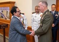 Chairman of the Joint Chiefs of Staff Gen. Joseph F. Dunford, Jr. greets Bahraini Minister for Defense Affairs Lt. Gen. Yusuf bin Ahmad bin Husayn al-Jalahma at the Pentagon in Washington D.C., Sept. 24, 2018