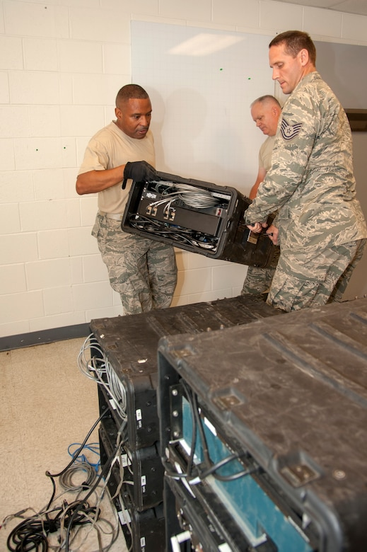 Airmen perform operational checks on equipment.