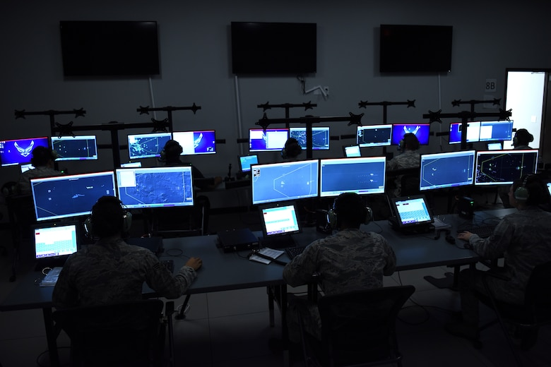 Airmen assigned to the 607th Air Control Squadron run simulations on the Battlespace Command and Control Center simulator, Sept. 21, 2018 at Luke Air Force Base, Ariz.