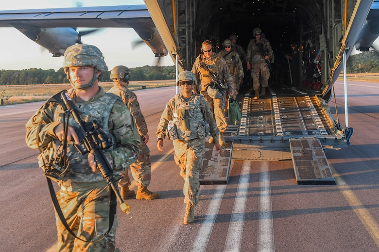 U.S. Army Soldiers and U.S. Air Force Airmen exit a C-130J Super Hercules after assessing a secondary airfield during Exercise Turbo Distribution 18-02 at Fort McCoy, Wisconsin, Sept. 9, 2018. The Joint Assessment Team arrives before the main component to survey potential airfields and cargo yard locations. (U.S. Air Force photo by Senior Airman Derek Seifert)