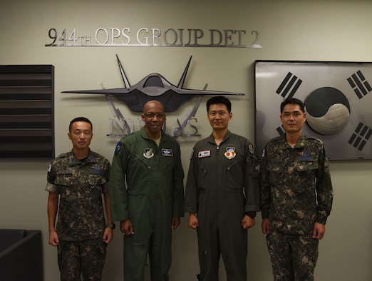 Gen. CQ Brown Jr., Pacific Air Forces commander poses with Republic of Korea Air Force members for a photo during his visit to Luke Air Force Base, Ariz., Sept. 20, 2018.
