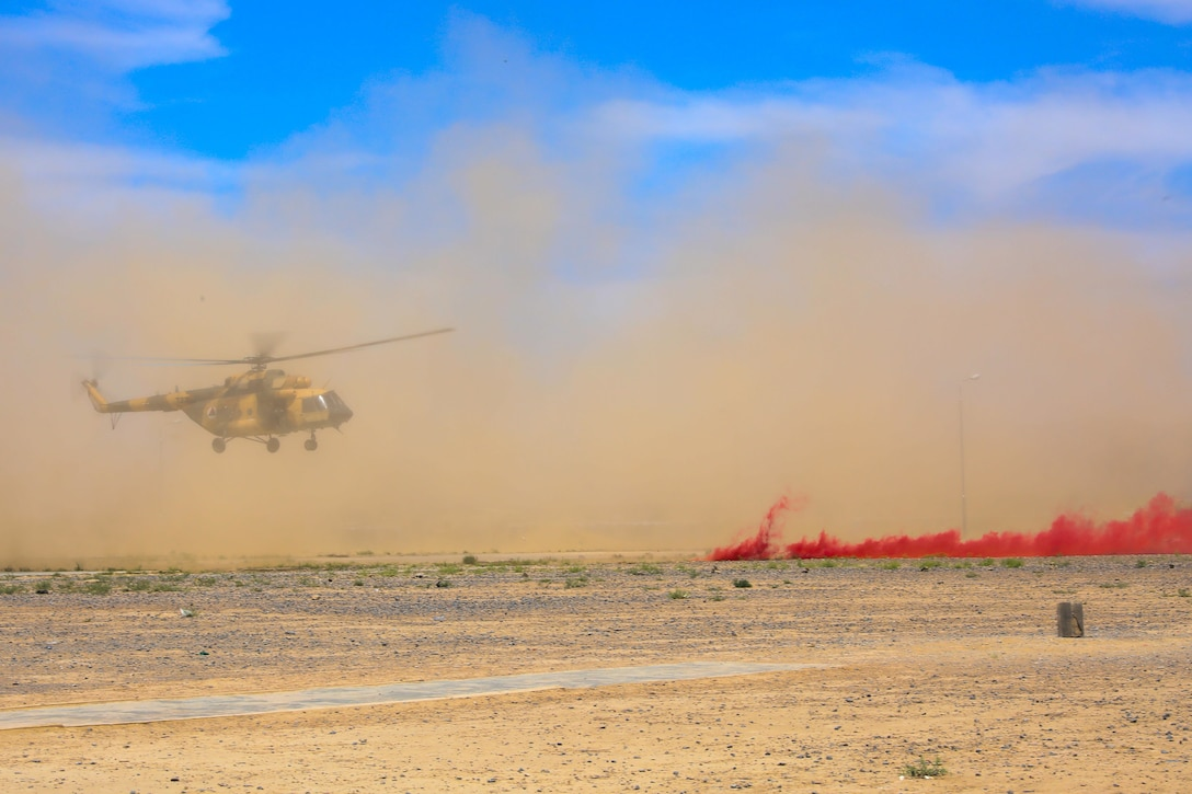 A Mi-17 from the Afghan air force prepares to land, May 8, 2018, at the Regional Military Training Center-Kandahar during a medical evacuation exercise hosted by Soldiers from the 2nd Battalion, 1st Security Force Assistance Brigade in Kandahar Afghanistan. (U.S. Army photo by Staff Sgt. Neysa Canfield/TAAC-South Public Affairs)