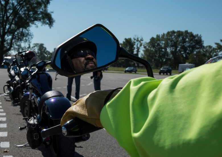 A participant in the motorcycle mentorship ride prepares for the start of the event Sept. 14, 2018 at Scott AFB, Ill. The event consisted of four safety briefs along the course of a five-hour road trip where riders were given the opportunity to practice safe riding techniques. (U.S. Air Force photo by Airman 1st Class Nathaniel Hudson)