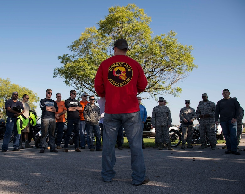 Senior Master Sgt. John Roskom, 375th Air Mobility Wing Plans, Programs and Readiness superintendent, gives a safety brief to a group of motorcyclists during the motorcycle mentorship ride Sept. 14, 2018 at Scott AFB, Ill. The event was held to give motorcycle riders with varying levels of experience a chance to get a refresher in motorcycle safety.