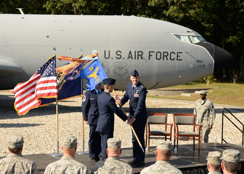 Col. Robert Hanovich Jr, commander of the 22nd Operations Group at McConnell Air Force Base, passes the 64th Air Refueling Squadron guidon to Lt. Col. Kevin Eley, who assumed command of the 64th ARS during a ceremony, Sept. 24, at Pease Air National Guard Base. (Photo by Master Sgt. Thomas Johnson, 157th ARW Public Affairs)