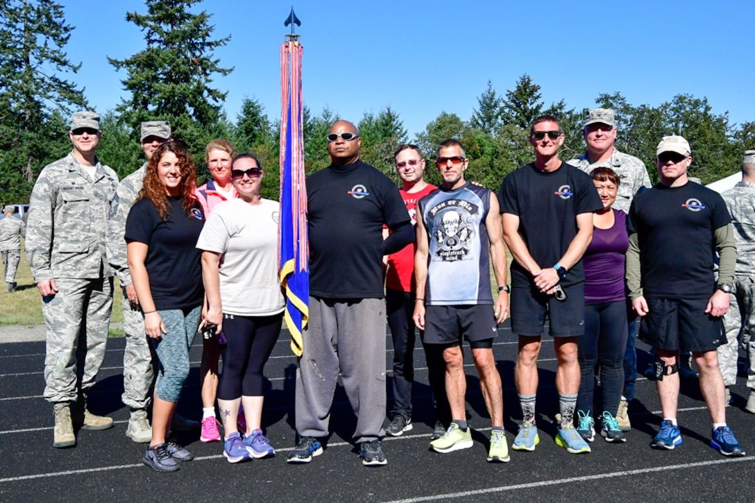 Members of the Western Air Defense Sector pose of a team photo after completing the 24-Hour POW/MIA Remembrance Run at the McChord Field track Sept. 19, 2018.  The WADS team completed 389 miles and place third in the overall team standings.  1st Lt. Kroby Keller place first in the individual standings with 100 miles and Bruce Robie placed second in the individual standings with 74 miles. (U.S. Air National Guard photo by Maj. Kimberly Burke)