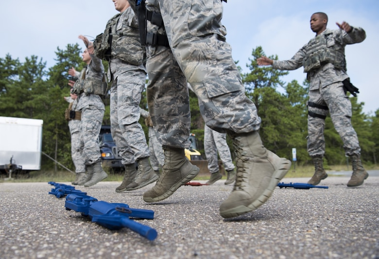 Security forces Airmen with Air Mobility Command exercise while training on Joint Base McGuire-Dix-Lakehurst, New Jersey, Sept. 5, 2018. The team spent three weeks preparing for the 2018 Air Force Defender Challenge that tested security forces Airmen's skills through weapons scenarios, dismounted operations and combat endurance. (U.S. Air Force photo by Airman Ariel Owings)