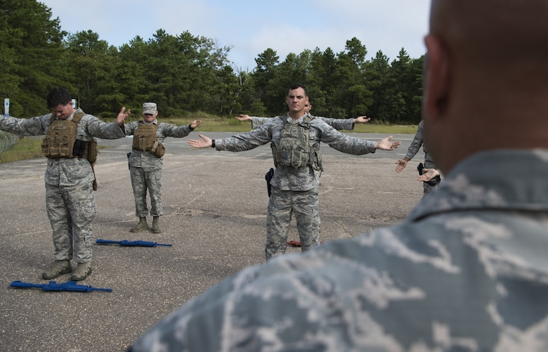 The Air Mobility Command team exercises on Joint Base McGuire-Dix-Lakehurst, New Jersey, Sept. 5, 2018. The team trained for three weeks together before the 2018 Air Force Defender Challenge. The challenge is a worldwide Air Force competition that pits security forces teams against each other in weapons scenarios, dismounted operations and combat endurance tests.(U.S. Air force photo by Airman Ariel Owings)