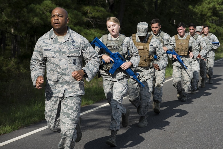 Security forces Airmen with Air Mobility Command train on Joint Base McGuire-Dix-Lakehurst, New Jersey, for the 2018 Air Force Defender Challenge Sept. 5, 2018. To qualify for the competition, security forces members tried out by completing a 6-mile run carrying 25-35 pounds in under two hours; a stress shoot with an M4 carbine and M9 pistol; a CrossFit Hero workout; a test of their reaction to near and far ambushes; an obstacle course; and field operations fire team movements. (U.S. Air Force photo by Airman Ariel Owings)