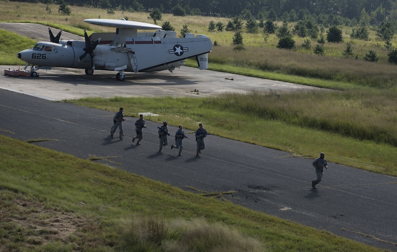 Security forces Airmen with Air Mobility Command run in full gear during while training for the 2018 Air Force Defender Challenge on Joint Base McGuire-Dix-Lakehurst, New Jersey, Sept. 5, 2018. The AMC team was one of 14 teams representing each of the 10 Air Force major commands, the Air National Guard, the Air Force District of Washington and German and British Royal air forces. (U.S. Air Force photo by Airman Ariel Owings)