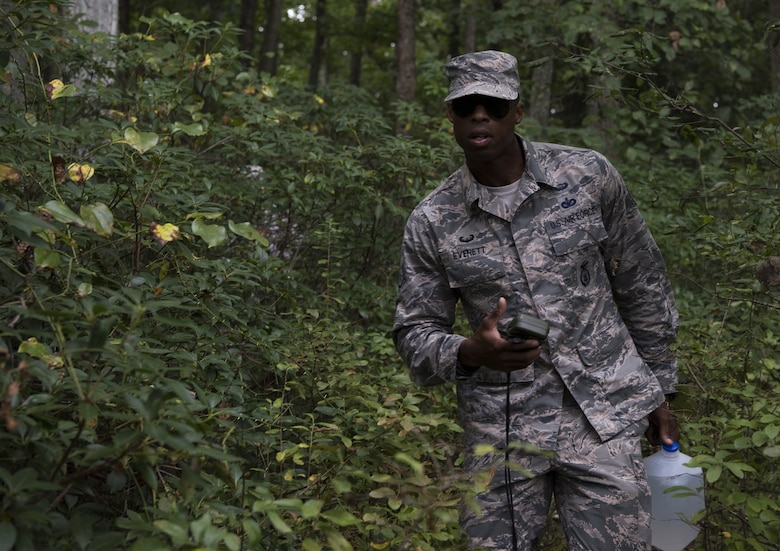 U.S. Air Force Staff Sgt. Zachary Everett, Dover Air Force Base, Delaware, 436th Security Forces Squadron response force leader, follows a GPS during land navigation training on Joint Base McGuire-Dix-Lakehurst, New Jersey, in preparation for representing Air Mobility Command in the 2018 Air Force Defender Challenge, Sept. 7, 2018. Land navigation was part of the dismounted operations portion of the competition, which the AMC team won. Each team was comprised of four main competitors and two alternatives and selected based on their performance and progression when the teams first began training.
