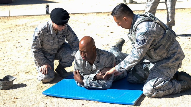 Chaplain (Capt.) Richardson Honore gets tased by 412th Security Forces Squadron personnel as part of a capabilities demonstration at Edwards Air Force Base, California, Sept. 13, 2018. Honore serves as the 412th SFS chaplain and volunteered to be tased in order to get better understanding of different stress factors that Defenders face every day. (U.S. Air Force photo by Giancarlo Casem)