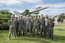 Japan Air Self-Defense Force and U.S. Air Force personnel stand united for a group photo during a Bilateral Exchange Program visit at Misawa Air Base, Japan, Sept. 18, 2018. The group split into pairs to learn the differences and similarities of each other's careers over the course of 10 days. (U.S. Air Force photo by Senior Airman Sadie Colbert)
