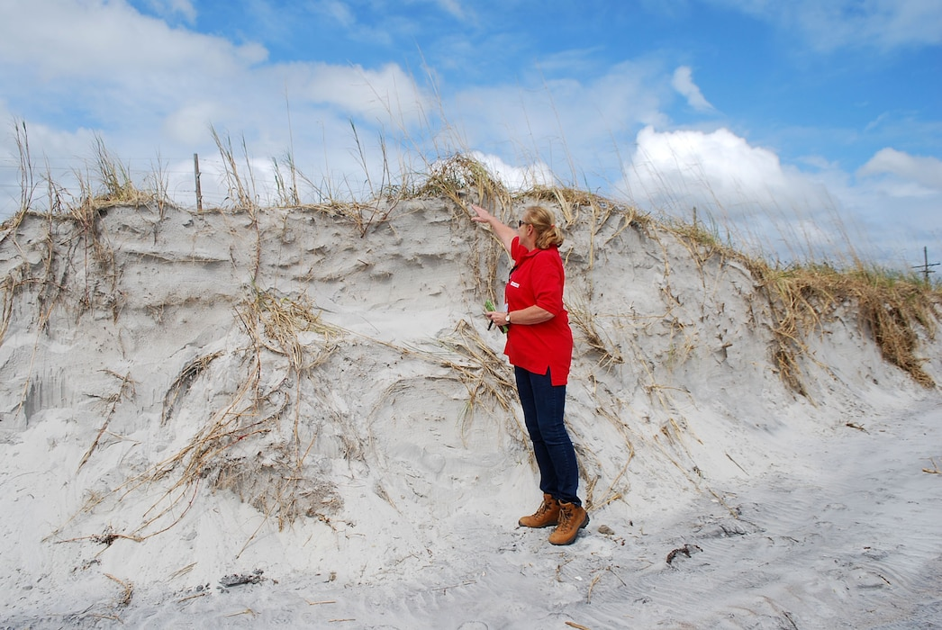 Wilmington District Project Manager Pamela Castens assesses damage at the top of a berm at North Topsail Island in this file photo. Washington (January 13, 2020) - The U.S. Army Corps of Engineers (Corps)  announced today work that it will accomplish with Construction account funding provided in Public Law 116-20, the Additional Supplemental Appropriations Disaster Relief Act, 2019, signed into law June 6, 2019. (USACE photo by Lisa Parker)
