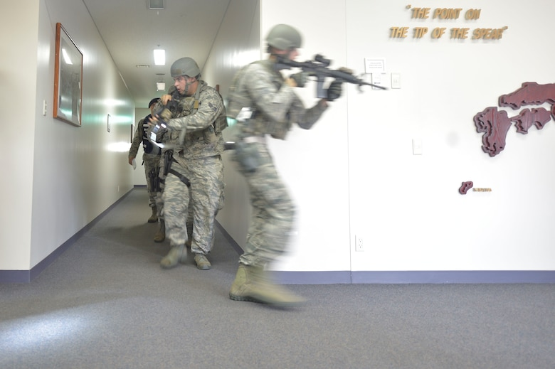 U.S. Air Force Senior Airman Daniel Anders, left, and Airman 1st Class Michael Curran, right, both 35th Security Forces Squadron defenders, perform a search of the Tori building during an active shooter exercise at Misawa Air Base, Sept. 18, 2018. Active shooter exercises are held to test base safety and security in case of a real-world scenario. (U.S. Air Force photo by Tech. Sgt. Stephany Johnson)