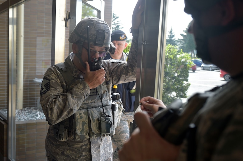 U.S. Air Force Master Sgt. William Castro, the 35th Security Forces Squadron bravo flight chief, talks on a radio during an active shooter exercise at Misawa Air Base, Sept. 18, 2018. The training exercise focused on how quickly and effectively first responders locate the source of the threat, while treating victims. (U.S. Air Force photo by Tech. Sgt. Stephany Johnson)