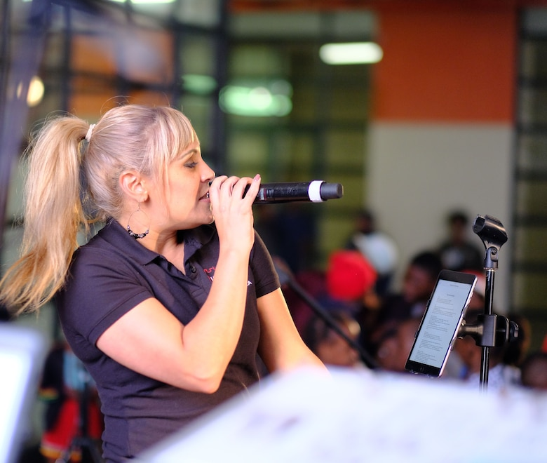 Senior Airman Linda Casul, the vocalist in the United States Air Forces in Europe -– Air Forces Africa band Touch 'n Go, sings for children during a concert at Ponte City in Johannesburg, South Africa, September 21, 2018. The band's performance provides a unique opportunity for the U.S. to build strong ties with its African partners and their communities.  (US Army Photo by Staff Sgt. Jeffery Sandstrum)