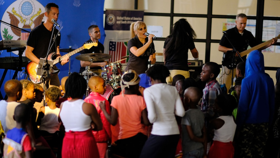 Members of the United States Air Forces in Europe- Air Forces Africa band  Touch 'n Go perform a concert for children at Ponte City in Johannesburg, South Africa, September 21, 2018. The band's performance provides a unique opportunity for the U.S. to develop strong connections with its African partners and their communities. (US Army photo by Staff Sgt. Jeffery Sandstrum)