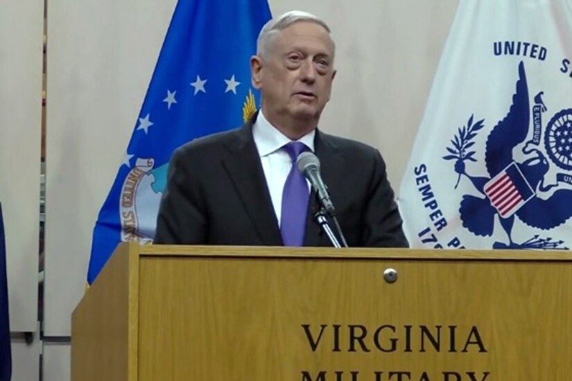 Defense Secretary James N. Mattis speaks from behind a podium.