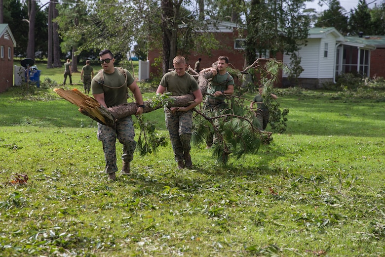 U.S. Marines with Marine Corps Air Station New River conduct a clean up effort after Hurricane Florence at McCutcheon Manor on MCAS New River, N.C., Sept. 17, 2018. Hurricane Florence impacted Marine Corps Base Camp Lejeune and MCAS New River with periods of strong winds, heavy rains, flooding of urban and low lying areas, flash floods and coastal storm surges.  (U.S. Marine Corps photo by Lance Cpl. Damaris Arias)