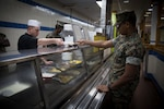 U.S. Marine Corps Cpl. Christopher Modro with 10th Marine Regiment, 2nd Marine Division, serves breakfast to Lance Cpl. Giovani DeleonAcosta, a food service specialist with Headquarters Battalion, 2nd Marine Division, at Camp Lejeune, N.C., Sept. 18, 2018