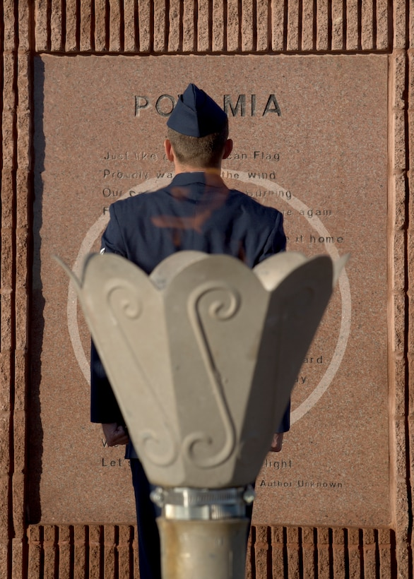 Staff Sgt. Christian Tone, an electrical systems craftsman for the 635th Material Maintenance Squadron, stands at attention in front of the POW/MIA Memorial at Heritage Park on Holloman Air Force Base, N.M., Sept. 21, as part of the 2018 POW/MIA Remembrance Day. Holloman Airmen took turns standing 24-hours straight for the vigil, honoring service members who were imprisoned and remain missing-in-action. (U.S. Air Force photo by Airman 1st Class Kindra Stewart)