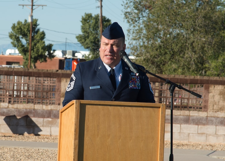 Senior Master Sgt. John Chacon, 49th Civil Engineer Squadron operations superintendent, speaks at the POW/MIA ceremony at Heritage Park on Holloman Air Force Base, N.M., Sept. 21. The ceremony, in rememberance of prisoners-of-war and those still missing-in-action, was part of Holloman's POW/MIA commemoration. (U.S. Air Force photo by Airman 1st Class Kindra Stewart)
