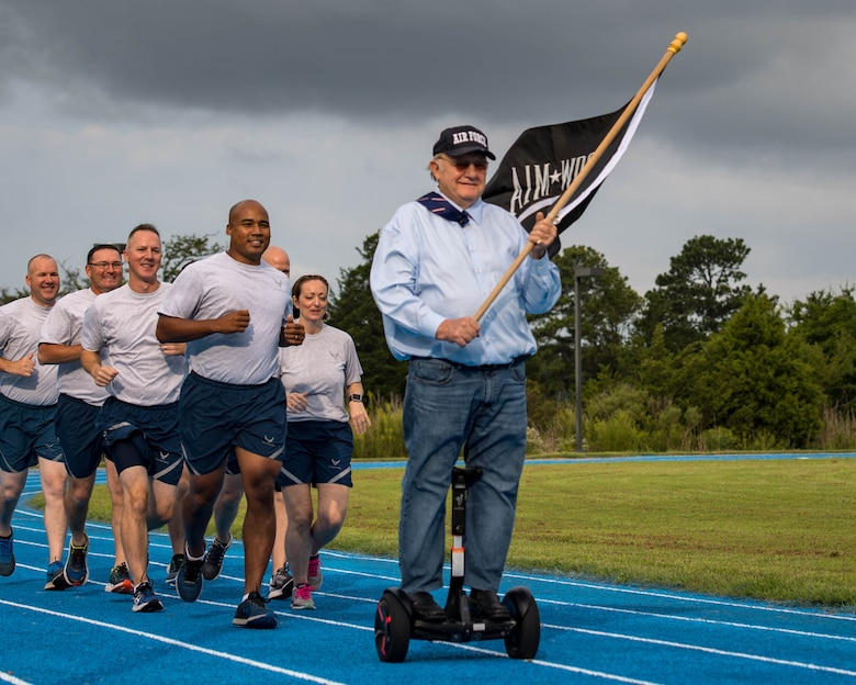 "U.S. Air Force Retired William ""Blister"" Townsley leads the first two laps during the POW/MIA 24-hour Recognition Run opening ceremony at Joint Base Langley-Eustis, Virginia, Sept. 21, 2018."