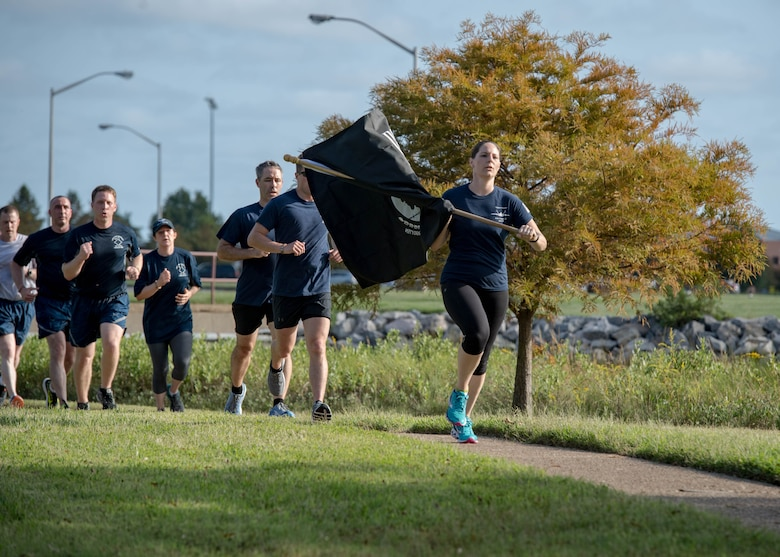 U.S. Air Force Airmen from the Air Force Sergeants Association Raptor Chapter 358 finish the POW/MIA 24-hour Recognition Run at the POW/MIA Memorial on Joint Base Langley-Eustis, Virginia, Sept. 21, 2018.