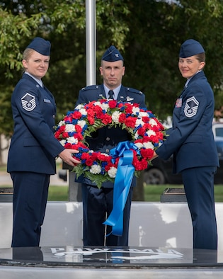 U.S. Air Force Master Sgt. Sharon Nichols, Air Combat Command Directorate of Air and Space Operations command and control manager, Col. Steven Fino, 1st Fighter Wing vice commander, and Senior Master Sgt. Vanessa Johnston, ACC Intelligence Directorate, 1A8XX Air Force Specialty manager, lay a wreath during the POW/MIA 24-hour Recognition Run closing ceremony at Joint Base Langley-Eustis, Virginia, Sept. 21, 2018.