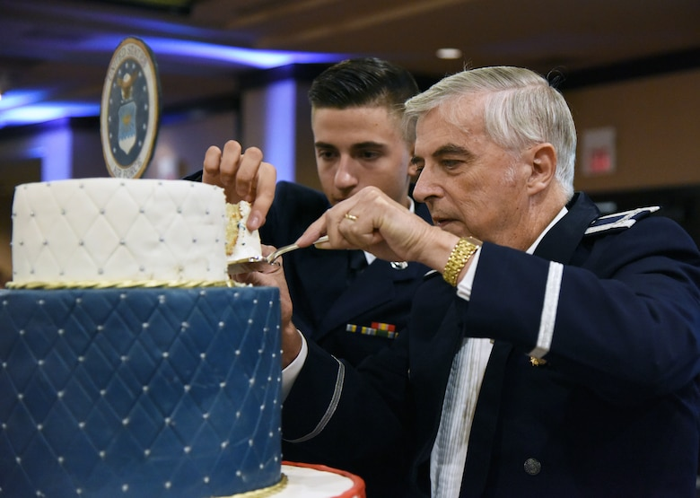 U.S. Air Force Airman 1st Class Warren Crouch, 334th Training Squadron student, and retired Col. Thomas Adams, participate in a cake cutting ceremony the U.S Air Force 71st Birthday Ball at the Imperial Palace Casino, Biloxi, Mississippi, Sept. 22, 2018. The event was hosted by the 81st Training Wing and the John C. Stennis Chapter Air Force Association. (U.S. Air Force photo by Kemberly Groue)