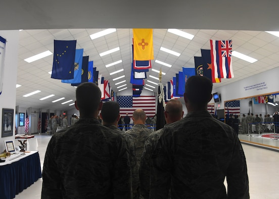 Master Sgt. Daniel Cable, 319th Operations Squadron first sergeant, center, stands at attention with his element as they wait for their cue to place a POW/MIA flag in place at a commemorative ceremony September 21, 2018, on Grand Forks Air Force Base, North Dakota. The ceremony was to honor those who are, or ever were, prisoners of war or missing in action. According to the Defense POW/MIA Accounting Agency, more than 82,000 Americans remain missing. (U.S. Air Force photo by Airman 1st Class Elora J. Martinez)