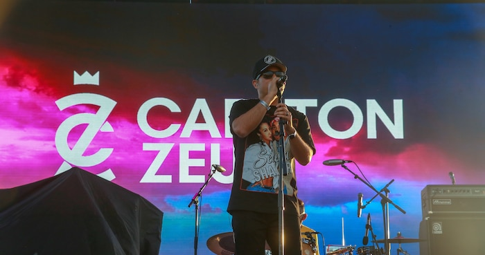 Carlton Zeus, a former Airman turned hip-hop artist, performs during the BaseFest music festival, held at Lance Cpl. Torrey L. Gray Field, aboard the Marine Corps Air Ground Combat Center, Twentynine Palms, Calif., Sept. 22, 2018. Hosted by USAA, with the help of Marine Corps Community Services, BaseFest gave Marines, their families and the local community the opportunity to unwind and listen to live music, while building bonds between the installation and the community. (U.S. Marine Corps photo by Lance Cpl. Dave Flores)