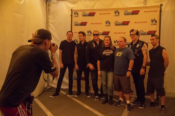 The Offspring, a popular rock band from Southern California, take photos during the fan meet and greet before their performance at the BaseFest music festival held at Lance Cpl. Torrey L. Gray Field aboard the Marine Corps Air Ground Combat Center, Twentynine Palms, Calif., Sept. 22, 2018. Hosted by USAA, with the help of Marine Corps Community Services, BaseFest gave Marines, their families and the local community the opportunity to unwind and listen to live music, while building bonds between the installation and the community. (U.S. Marine Corps photo by Lance Cpl. Dave Flores)
