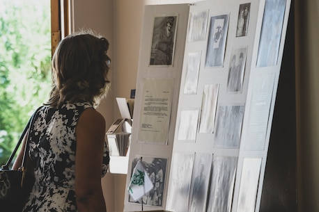 An attendee of Tech. Sgt. Dorothy L. Angil's funeral service views photos and letters pertaining to Angil's time in service, at Twentynine Palms United Methodist, Twentynine Palms, Calif., Sept. 22, 2018. Angil enlisted in the Marine Corps in 1943, in support of World War II. She also went on to support the Korean War war effort. (U.S. Marine Corps photo by Lance Cpl. Rachel K. Young)