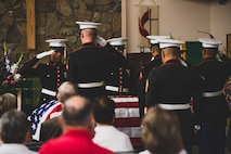 The U.S. Marine Corps Honor Guard presents arms to fallen Tech. Sgt. Dorothy L. Angil at the Twentynine Palms United Methodist, Twentynine Palms, Calif., Sept. 22, 2018. Angil enlisted in the Marine Corps in 1943, in support of World War II. She also went on to support the Korean War war effort. (U.S. Marine Corps photo by Lance Cpl. Rachel K. Young)