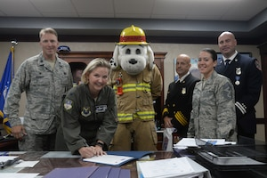 From left to right – Lt. Col. Alex Mignery, 341st Civil Engineer Squadron commander; Col. Jennifer Reeves, 341st Missile Wing commander; Sparky the Fire Dog; Rickey Naccarato, 341st CES assistant fire chief; Chief Master Sergeant Eryn McElroy, 341st MW command chief; and Michael Johns, 341st CES fire inspector, officially recognize Fire Prevention Week as Oct. 7-13 at Malmstrom Air Force Base, Mont., with a signing of a proclamation Sept. 26, 2018. (U.S. Air Force photo by Airman 1st Class Tristan Truesdell)