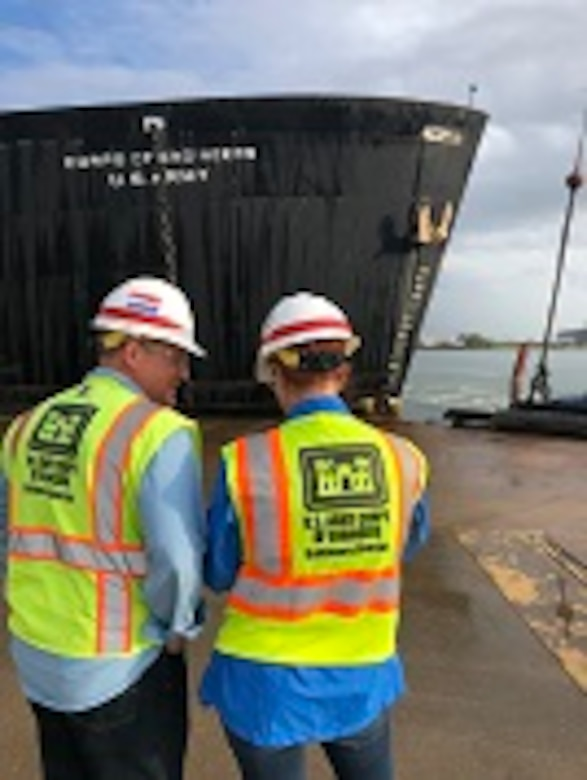 Radiological Health Physicist Hans Honerlah, the program manager for Baltimore District's Radiological Center of Expertise, and STURGIS decommissioning Project Manager Brenda Barber watch Tuesday morning September 25, 2018 as crews finish the rigging necessary for STURGIS to be towed from Galveston, Texas to Brownsville, Texas for her final shipbreaking and recycling. Over the past three years in Galveston, Texas, the U.S. Army Corps of Engineers has been implementing the challenging and complex efforts to decommission the MH-1A — the deactivated nuclear reactor that was onboard the STURGIS vessel. (Photo by Chris Gardner)