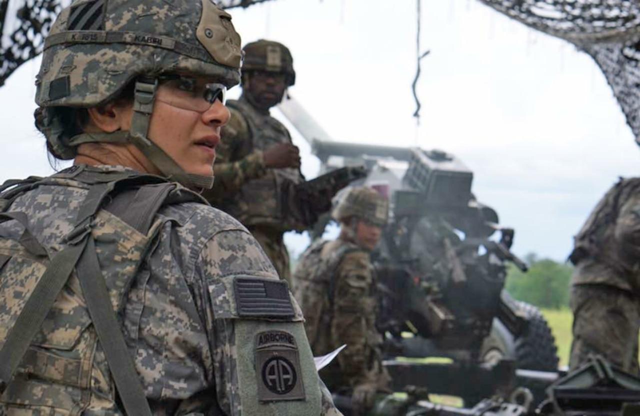 Army Capt. Nargis Kabiri, commander of Alpha Battery, 1st Battalion, 9th Field Artillery Regiment, 3rd Infantry Division Artillery, helps her team prepare an M119 Howitzer on Fort Stewart, Ga.