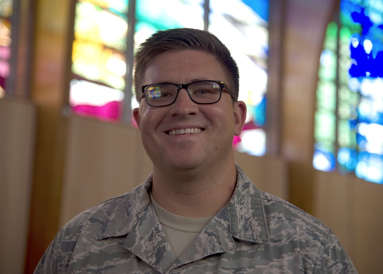 Staff Sgt. Colin Owens, 49th Wing Chapel religious affairs Airman, poses for a photo inside the base chapel Sept. 17 on Holloman Air Force Base, N.M. After cross-training from air traffic control to religious affairs, Owens arrived at Holloman in November 2017, to begin his new career. (U.S. Air Force photo by Airman 1st Class Kindra Stewart)