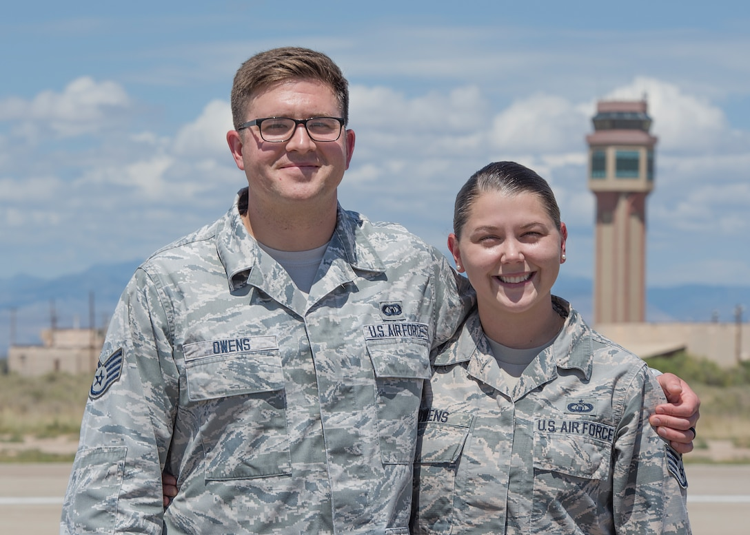 Staff Sgt. Colin Owens, 49th Wing Chapel religious affairs Airman, and Staff Sgt. Kristen Owens, 49th Operations Support Squadron air traffic controller, pose for a photo outside the air traffic control tower Aug. 23 on Holloman Air Force Base, N.M. While stationed at MacDill Air Force Base, Fla., Colin met and married his wife, Kristen, a fellow air traffic controller. (U.S. Air Force photo by Airman 1st Class Kindra Stewart)