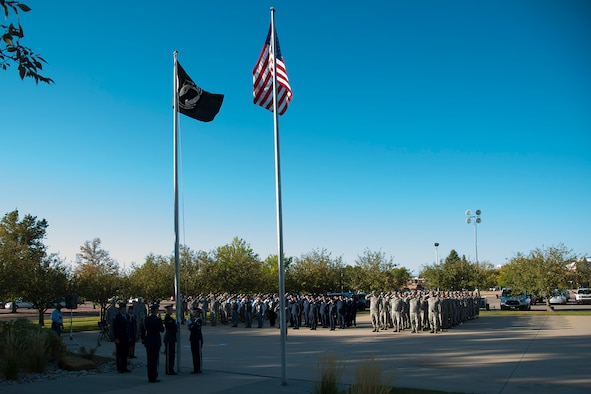 PETERSON AIR FORCE BASE, Colo. – The Honor Guard raises the prisoner of war/missing in action flag during reveille on Peterson Air Force Base, Colorado, Sept. 17, 2018. Reveille kicked off POW/MIA Remembrance Week, Sept. 17-21, 2018. (U.S. Air Force photo by Robb Lingley)
